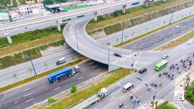 Cận cảnh dự án giao thông đang giúp mở rộng cửa ngõ phía Đông TP.HCM - Ảnh 7.