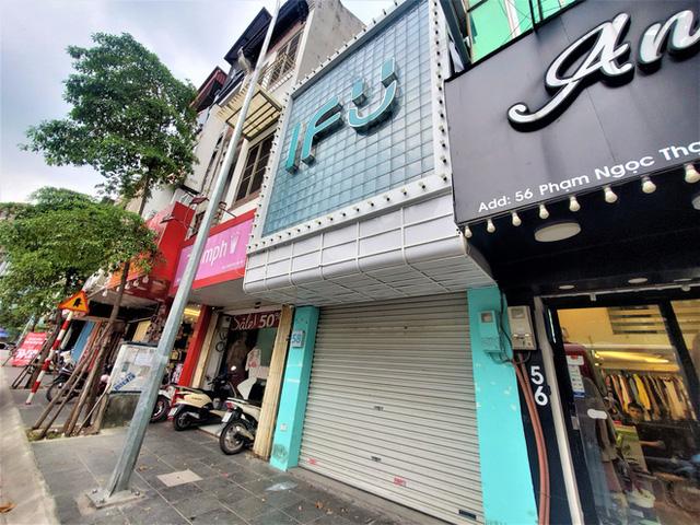 IFU đóng loạt cửa hàng giữa tâm bão âm thầm tráo nhãn mác quần áo - Ảnh 7.