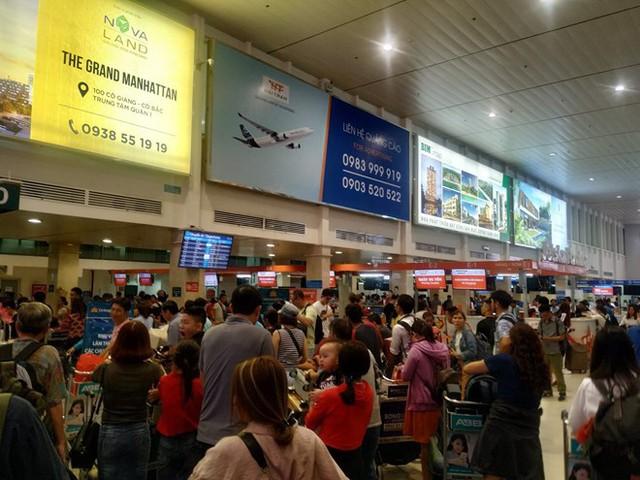 Sân bay Tân Sơn Nhất sắp ngưng sử dụng loa thông báo: Làm thế nào để thích nghi và không bị trễ giờ bay? - Ảnh 4.