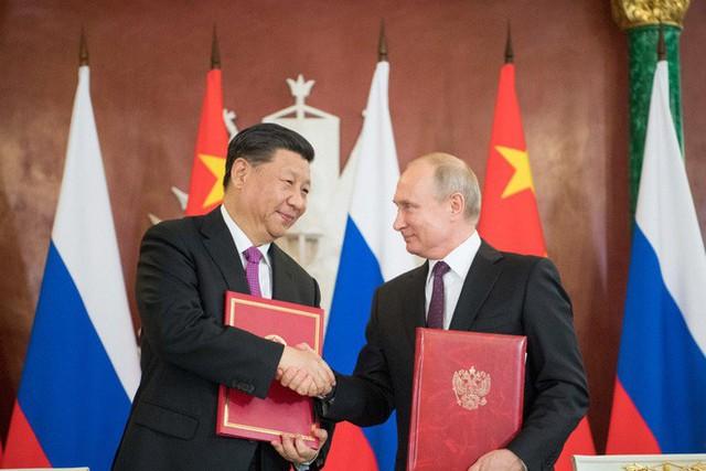 Ngồi bên ông Tập Cận Bình, TT Putin 7 lần vỗ mặt Mỹ không nể nang: Không hổ danh là người bạn tốt nhất! - Ảnh 1.