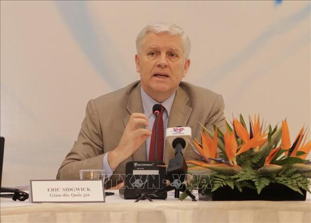 ADB: Chiến tranh thương mại biến thành chiến tranh tiền tệ sẽ tạo ra rủi ro mới đối với kinh tế Việt Nam - Ảnh 2.