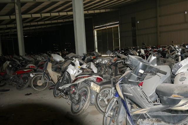 Cận cảnh hàng nghìn xe vi phạm giao thông đang bị giam giữ tại các kho bãi - Ảnh 7.