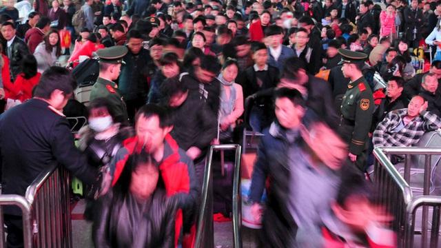 Ba tỷ chuyến đi trong dịp Tết Nguyên Đán: Trung Quốc trước nguy cơ lan truyền virus gây bệnh phổi bí ẩn - Ảnh 2.