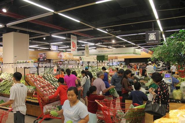 Chưa nghỉ tết, siêu thị đã đông nghẹt người - Ảnh 10.