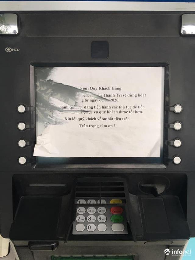 Tái diễn tình trạng ATM tê liệt, ngừng hoạt động... trong ngày cận Tết - Ảnh 3.