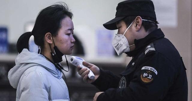 """Người dân Vũ Hán lo sợ khi bệnh viện quá tải: """"Virus truyền nhiễm có thể đang ở ngay bên cạnh mà bạn không biết""""  - Ảnh 3."""