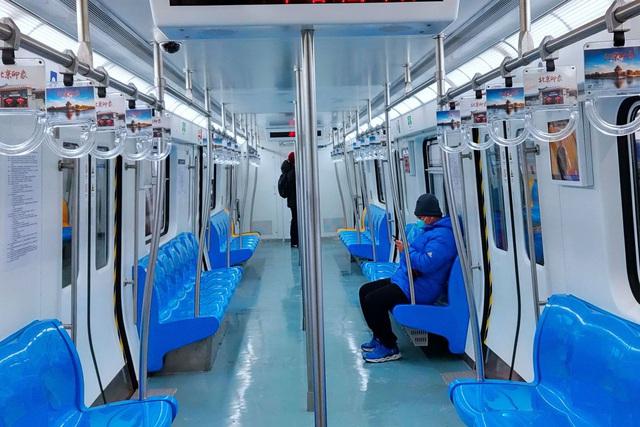 Chùm ảnh những siêu đô thị nhộn nhịp của Trung Quốc hóa thành phố ma vì virus corona - Ảnh 12.