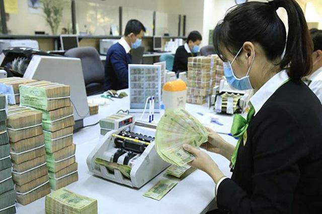 Dịch Covid-19 sẽ tác động ra sao đến nợ xấu các ngân hàng? - Ảnh 1.