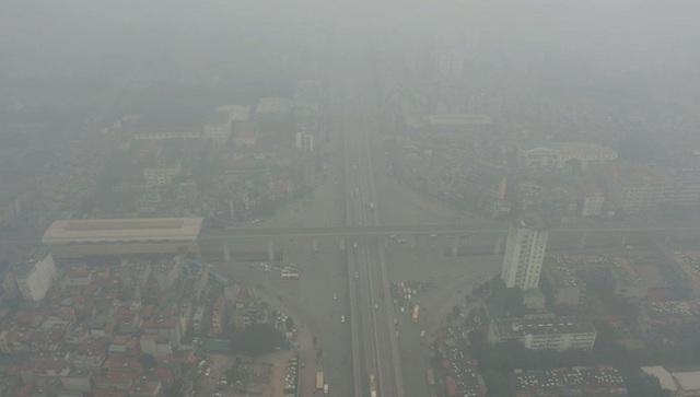 Nhiều tòa nhà mờ ảo nhìn từ flycam, chất lượng không khí ở Hà Nội suy giảm - Ảnh 5.