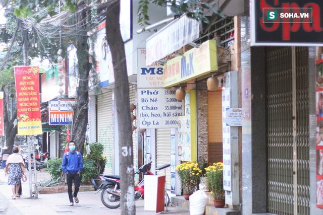 Nha Trang sau ca nhiễm virus corona đầu tiên từ người sang người: Không còn người Hoa, cửa hàng đóng vì ế ẩm - Ảnh 13.