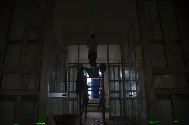 Chùm ảnh: Cận cảnh quá trình biến bệnh viện bỏ hoang ở Hà Nội thành khu cách ly dành cho 200 người - Ảnh 8.