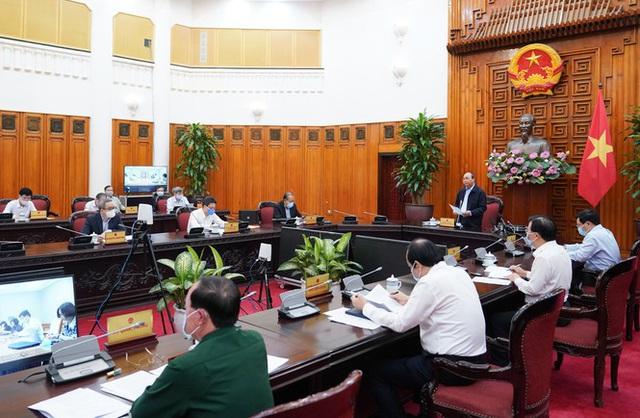 Thường trực Chính phủ thảo luận biện pháp thời kỳ tiền khẩn cấp - Ảnh 1.