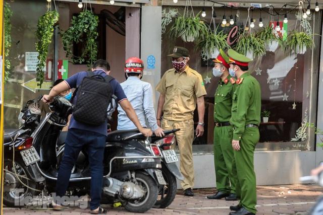 Hàng loạt quán cà phê đất vàng Hà Nội tạm thời đóng cửa - Ảnh 12.