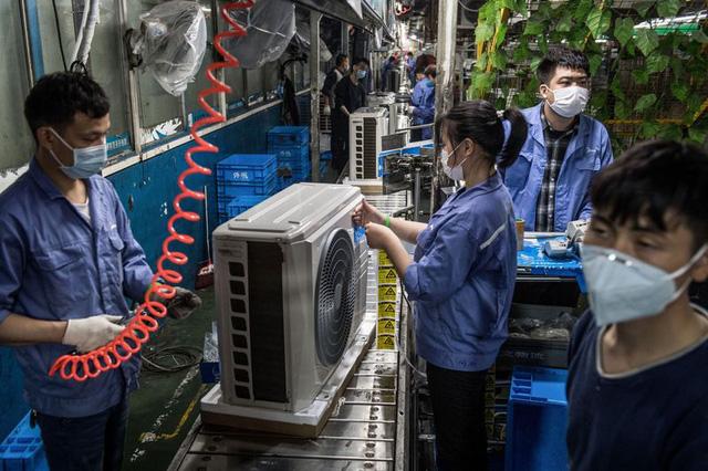 Cú sốc thứ 2 từ virus corona đang từng bước hạ gục các nhà máy ở Trung Quốc - Ảnh 2.