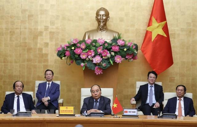Họp trực tuyến G20, Thủ tướng chia sẻ nhiều biện pháp hành động chung ứng phó COVID-19 - Ảnh 1.