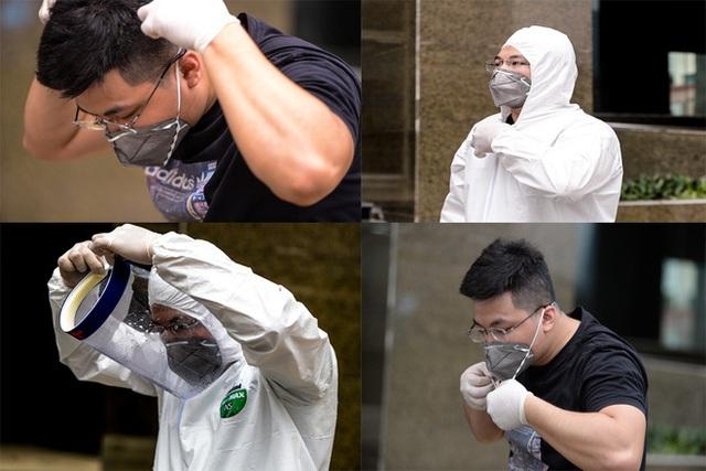 [Ảnh] 10 giờ của nhân viên y tế khi phun tiêu trùng, khử độc ở toà 34T, nơi nữ phóng viên nhiễm Covid-19 sinh sống - Ảnh 11.