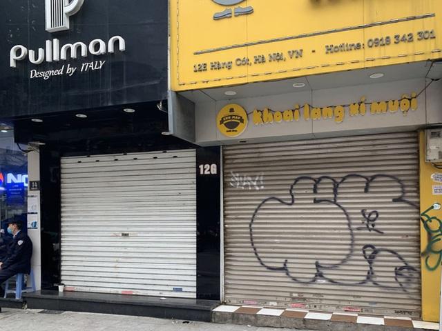 Nhiều cửa hàng tại phố cổ Hà Nội tạm dừng hoạt động - Ảnh 5.