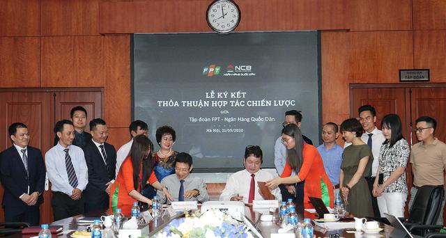 NCB ký kết Thỏa thuận hợp tác chiến lược với Tập đoàn FPT và Tập đoàn Gami - Ảnh 1.