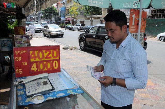 Campuchia bắt đầu lộ trình chống Đô la hóa nền kinh tế - Ảnh 1.