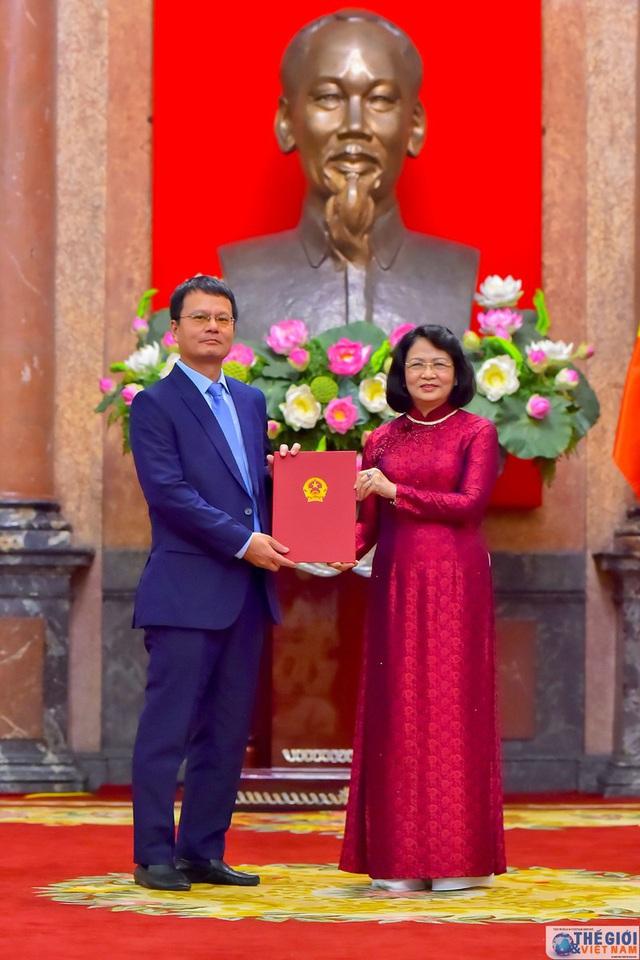 Chân dung 12 Đại sứ mới được Chủ tịch nước bổ nhiệm - Ảnh 12.