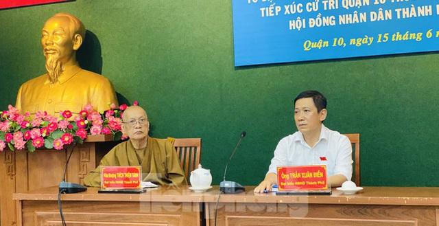 Lý do ông Tất Thành Cang tiếp tục vắng mặt buổi tiếp xúc cử tri - Ảnh 1.