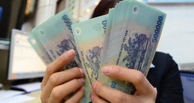 Tiền lương năm 2021 có giảm theo mức thắt chặt ngân sách? - Ảnh 1.