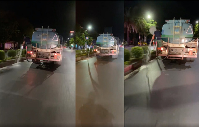Clip nhân viên công ty cây xanh không tưới cây mà cho vòi tưới xuống đường khiến dư luận bức xúc - Ảnh 1.
