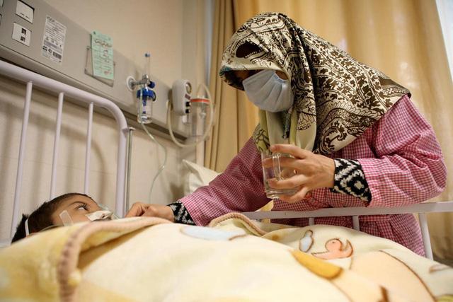 Ác mộng Covid-19 ở Iran: Số ca tử vong một ngày cao kỷ lục - Ảnh 1.