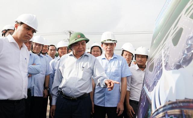 Thủ tướng trực tiếp rà soát tiến độ giải ngân đầu tư công các địa phương - Ảnh 1.