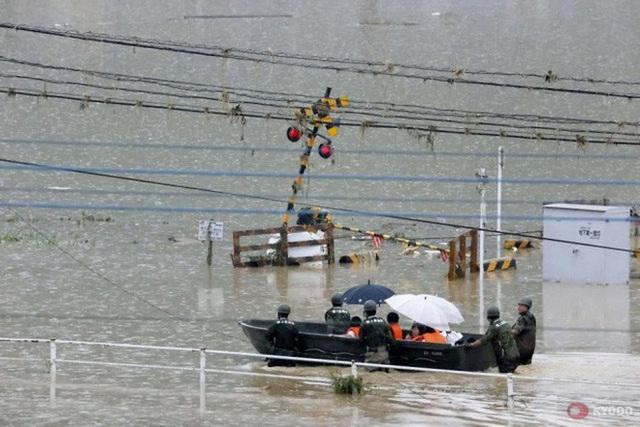 Trung Quốc: Mưa lớn không dứt, lũ lụt dồn dập, người chết gia tăng - Ảnh 4.