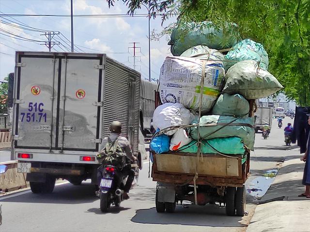 12 năm sau lệnh cấm, xe ba gác vẫn len lỏi khắp ngóc ngách Sài Gòn - Ảnh 3.