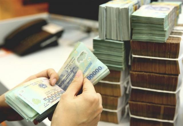 Thừa tiền, ngân hàng có nên mạnh tay giảm lãi suất? - Ảnh 1.