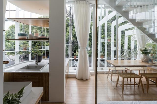 Công trình vừa là nhà cho 7 người ở, vừa là quán cà phê trên mảnh đất 35 m2 ở Huế - Ảnh 4.