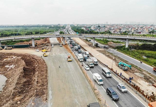Cận cảnh công trình kết nối vành đai 3 với cao tốc Hà Nội - Hải Phòng - Ảnh 1.