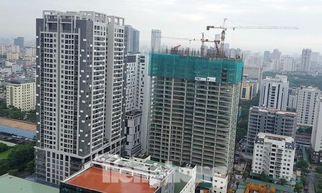 Yêu cầu Bộ Xây dựng làm rõ việc xây tầng lánh nạn đẩy giá căn hộ - Ảnh 1.