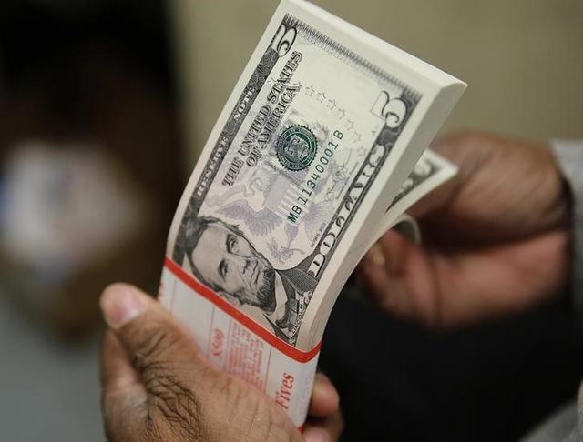 Triển vọng suy yếu của đồng USD - Ảnh 1.