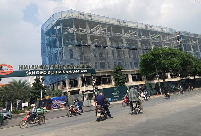 Cận cảnh cao ốc nhấn chìm con đường BT Hà Nội - Ảnh 9.