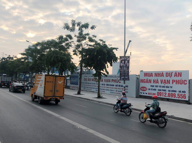 Cận cảnh cao ốc nhấn chìm con đường BT Hà Nội - Ảnh 10.