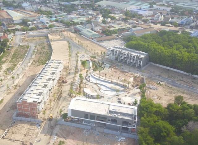 Bình Dương xử lý hai chủ đầu tư khu dân cư xây dựng trái phép - Ảnh 3.