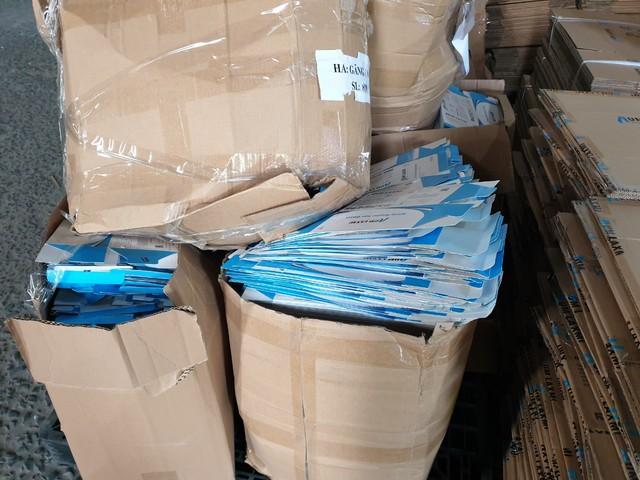 Phát hiện hơn 2 triệu chiếc găng tay y tế thành phẩm được tái chế từ găng tay y tế đã qua sử dụng - Ảnh 1.