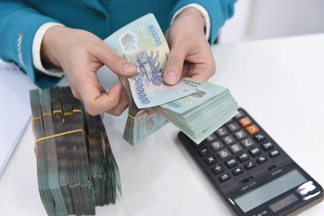 Kiến nghị ngân hàng giảm thêm lãi vay ít nhất 2%/năm  - Ảnh 1.