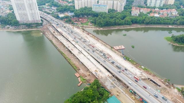 Hình ảnh cầu vượt thấp hồ Linh Đàm sắp thông xe - Ảnh 1.