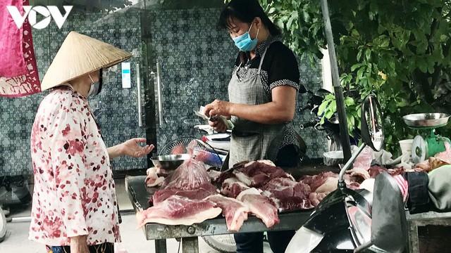 Thịt lợn bắt đầu giảm chứ không còn là giá trên ti vi - Ảnh 2.
