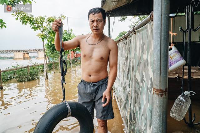 Ảnh, clip: Nước sông Hồng dâng cao, người dân Hà Nội bì bõm tập thể dục - Ảnh 11.