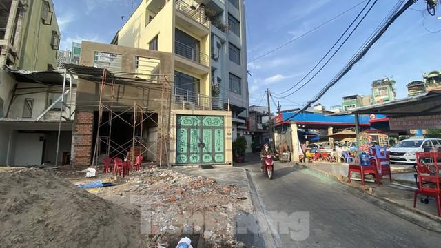 Người Sài Gòn dỡ nhà mặt phố bàn giao mặt bằng làm tuyến Metro Số 2 - Ảnh 1.