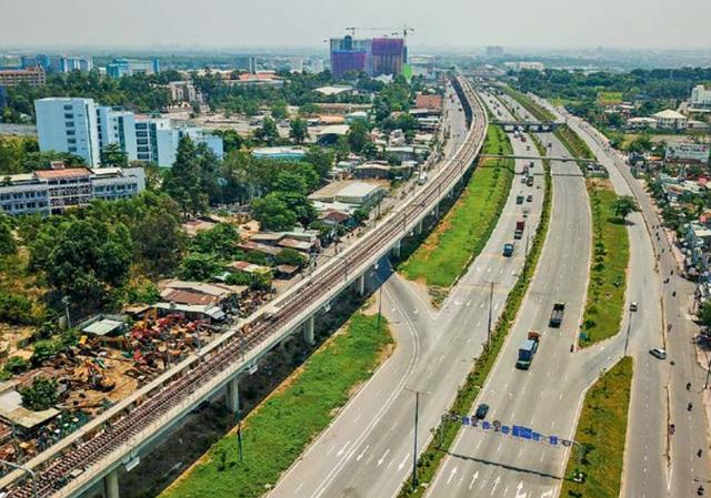 Phát triển đô thị vùng ven TP.HCM nhờ hạ tầng giao thông - Ảnh 1.