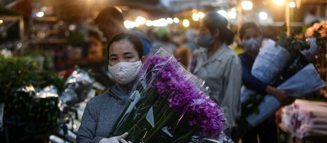 World Bank: Đã và đang kiểm soát đại dịch Covid-19 một cách ngoạn mục, Việt Nam có hai lợi thế để thoát khỏi Bẫy kinh tế Covid-19 - Ảnh 2.