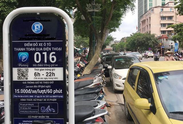 Trông xe theo iParking bị gỡ bỏ trên phố Hà Nội - Ảnh 1.