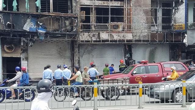 Triệu tâp người đàn ông, điều tra nghi án đốt phòng giao dịch Eximbank ở Gò Vấp  - Ảnh 1.