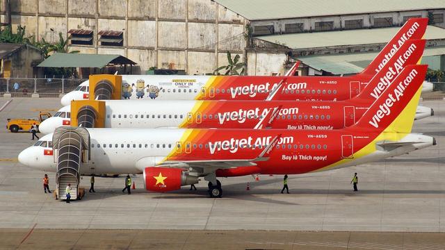 Động thái cơ cấu trái ngược của hai hãng hàng không - Ảnh 2.